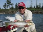 Ed Margola with a nice Rainbow taken on a dry fly. - Bow River Hookers - Bow River Fly Fishing Guide and Outfitter