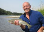 Casey Hodgson with a heavy Rainbow taken on a dry fly. - Bow River Hookers - Bow River Fly Fishing Guide and Outfitter