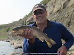 Casey Hodgson with another nice Rainbow taken on a dry fly. - Bow River Hookers - Bow River Fly Fishing Guide and Outfitter